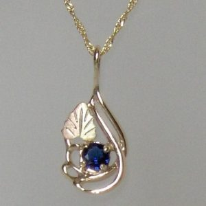 Whitaker's Black Hills Gold Pendant with 12K Bi-Colored Leaf & Ceylon Blue Sapphire