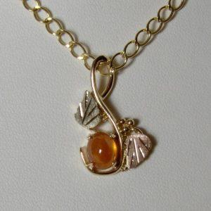 Whitaker's Black Hills Gold Mandarin Orange Spesserite Garnet Oval Pendant